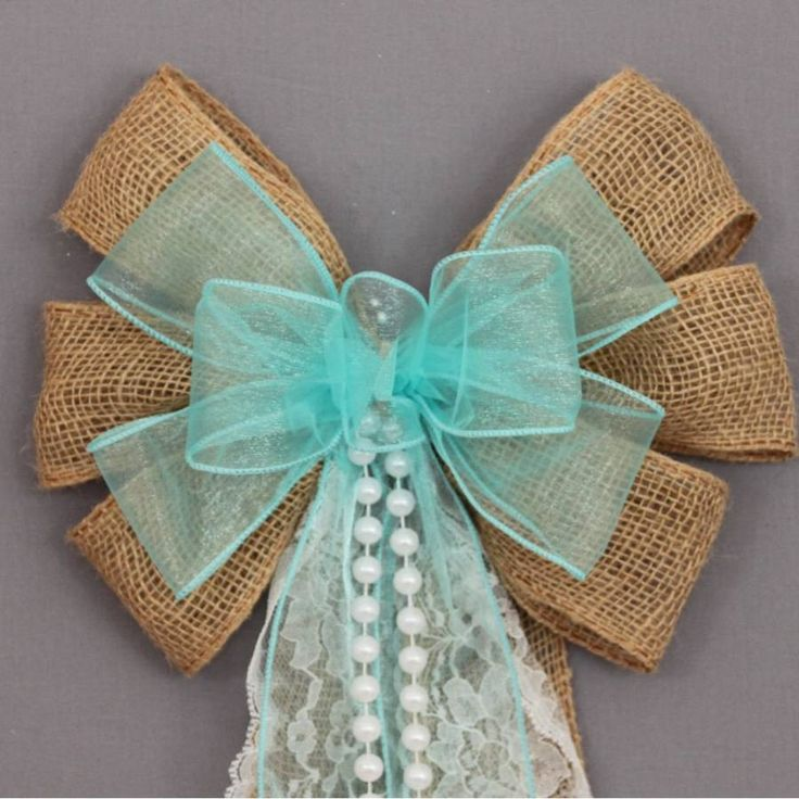"""This aqua sheer burlap wedding bow is accents with lace and pearls. This burlap pew bow is a perfect decoration for a rustic wedding theme. Bow Details: - 6 loops of 2 1/2"""" burlap with wire edge. (Not"""
