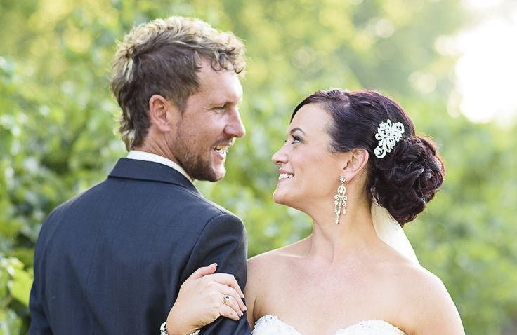 Low bun and curls for a beautiful bride by Total Brides hair & makeup