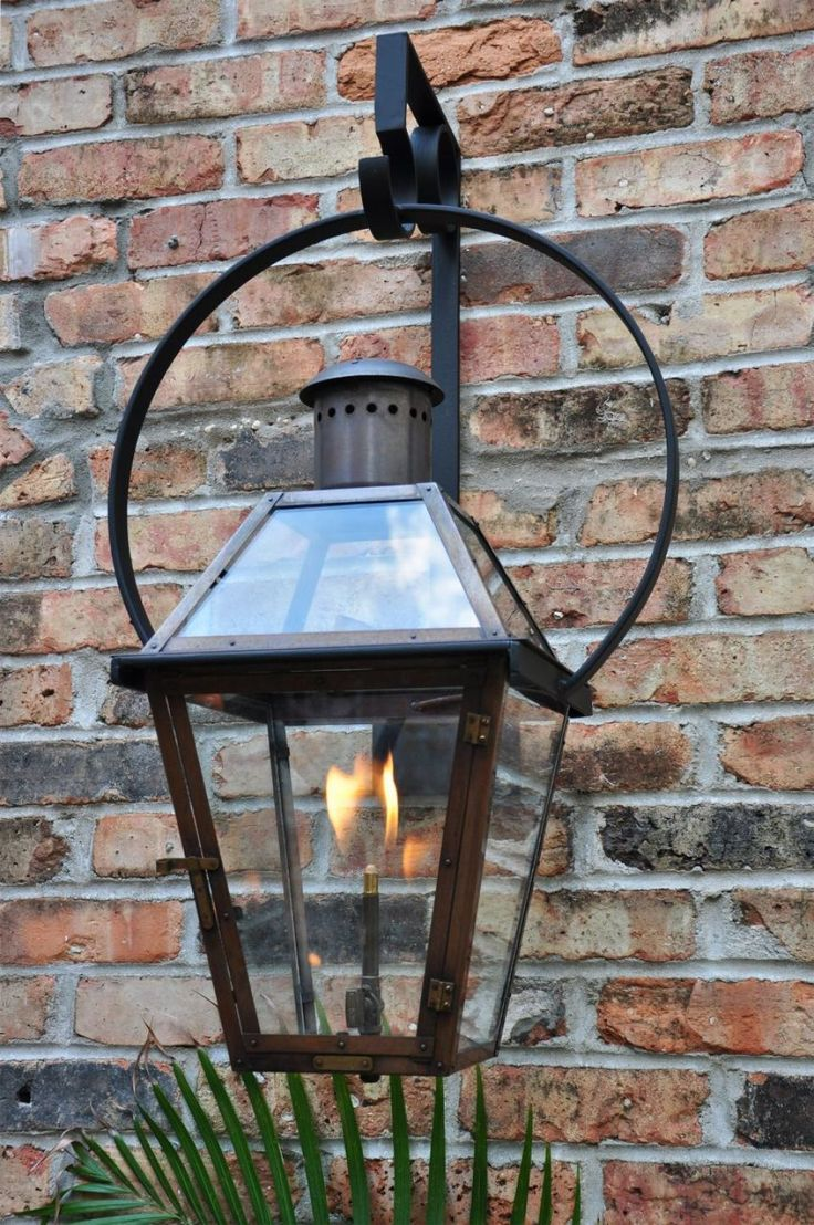 French Quarter on Yoke Hanger | The French Quarter on yoke hanger bracket is a perfect fit when you have a broad area to address. The light is still very versatile architecturally and can be used on almost any home. This light is available in natural gas, liquid propane, and electric. #neworleans #lanterns #bevolo