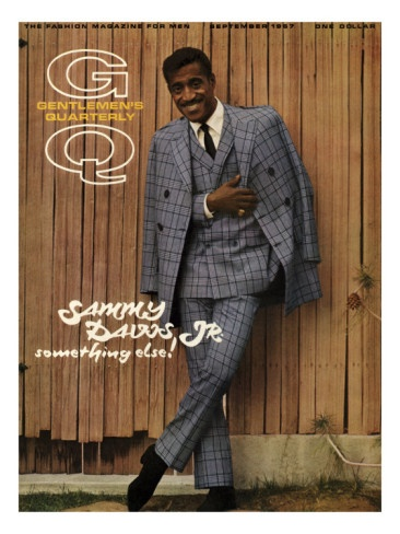 Sammy Davis, Jr. on the cover of 'GQ' magazine, September 1967. He is wearing a Sy Devore double-breasted suit of gray plaid with a slim black tie. Davis and other members of the Rat Pack, including Frank Sinatra and Dean Martin, were emulated through much of the 1960s for their too-cool style. Photo by Milton Greene.
