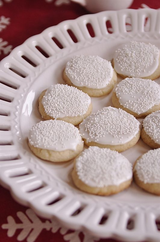 Sugar cookies frosted to look like snowballs.  Would be so cute in the Snowstorm in a Box