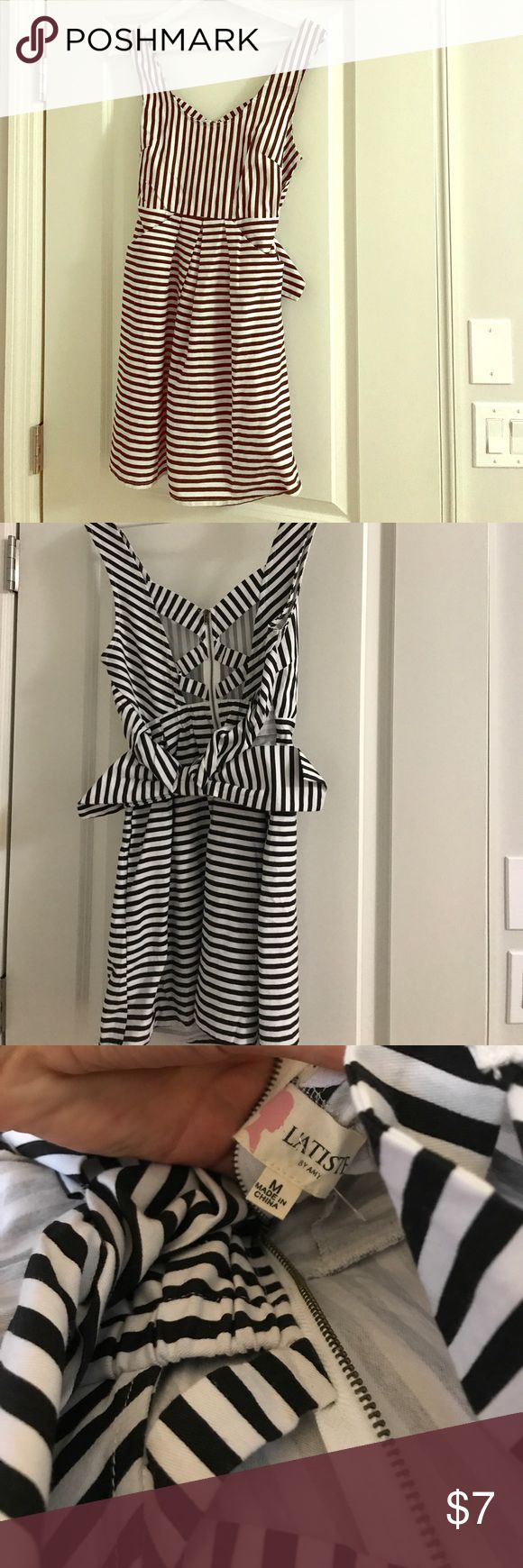 NWOT Black and White Striped L'atiste Dress Cute NWOT dress, size medium but seems more like a small. Never worn, came with some fabric snares from the boutique I bought it from so I am marking down the price. Cute bow in the back. Great for going out! l'atiste Dresses
