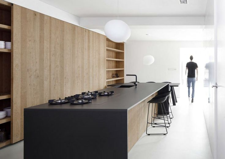 i29 Interior Architects, Garage Conversion, Amsterdam - Large Sliding doors to conceal shelving & storage for the Kitchen. Simple & Sleek