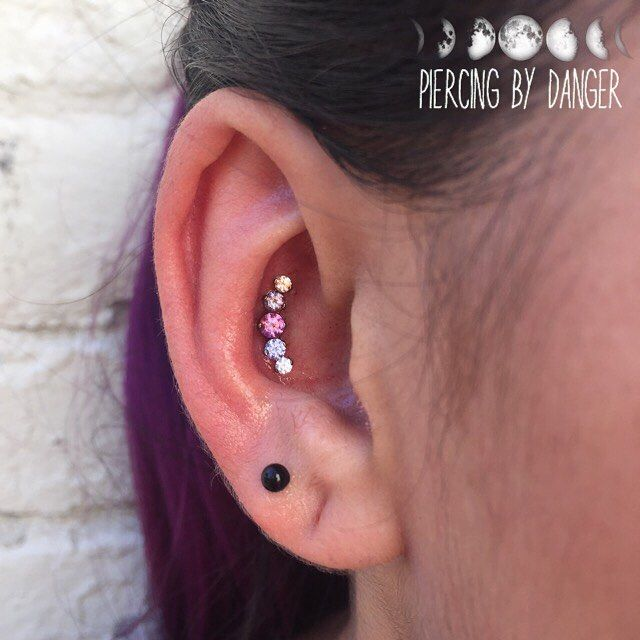 Fresh Conch piercing with Lavender Prium by Industrial Strength.  Piercing done at Energy Tattoo by Kara Danger.