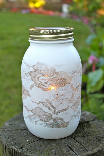 1. Use masking tape to put a strip of lace through the center of your mason jar.  2. Then spray whatever color you like (white is my favorite) on your gar with the lace on.  3. After that, let it dry and take the lace off.  and put candle (or whatever you want in it) would be pretty simple and cheap a centerpiece at a wedding. could put flowers in instead of a candle. Like the candle though (: