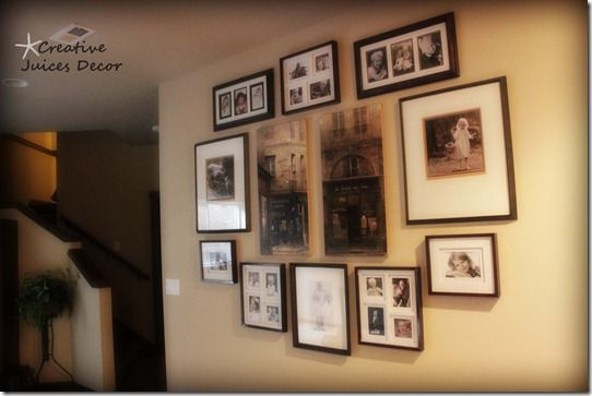 Best way to hang pictures on a photo gallery wall.  Use Wax paper over layout on floor with a black mark for the hooks....put up on wall, nail in the black mark, pull off the wax paper and your wall is DONE!