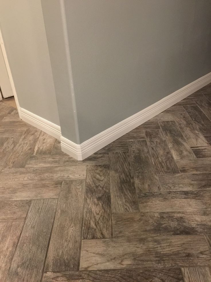 nice Tile plank floor from Home Depot-rustic bay. Looks great with Herringbone layout... for kids bathroom