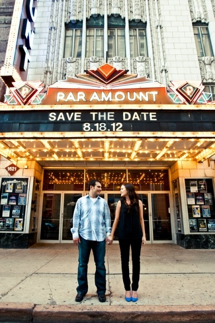 Save the Date -  Couple standing outside Paramount theater with date behind them on the theater sign