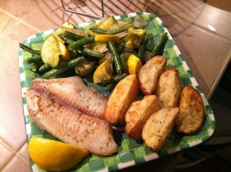 Tilapia and veggies from frozen! Healthy olive oil on the veggies and a little nonfat cooking spray on the potatoes to make them brown a little better. Another great NuWave meal cooked in under 30 minutes!