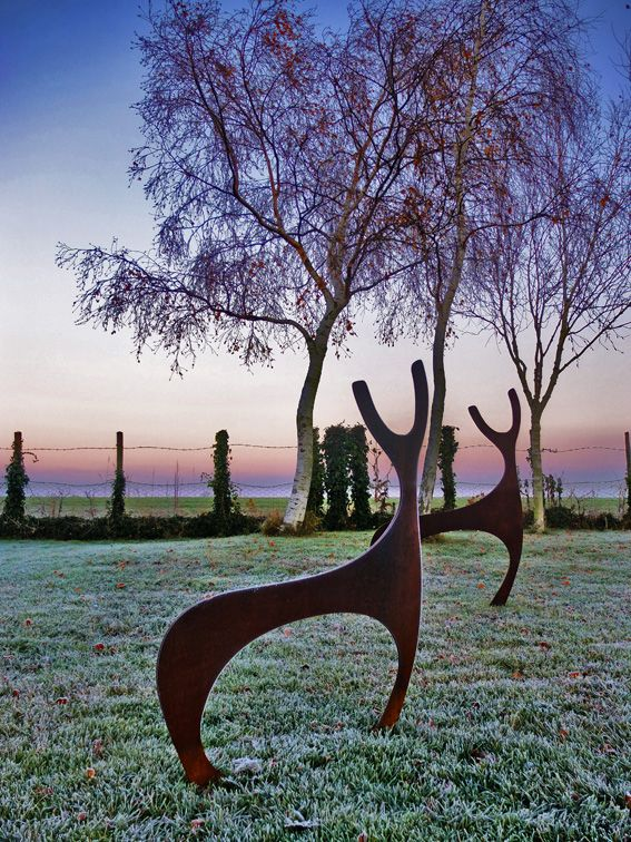 Steel Deer Sculptures at dawn