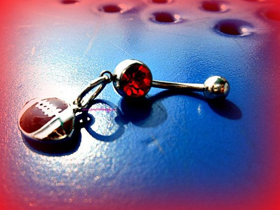 Red Football Belly RingTrendy Belly RingSports by #Queen2Bohemian #football #bellybuttonring #navelring #piercing #bodyjewelry #footballlover #sportslover
