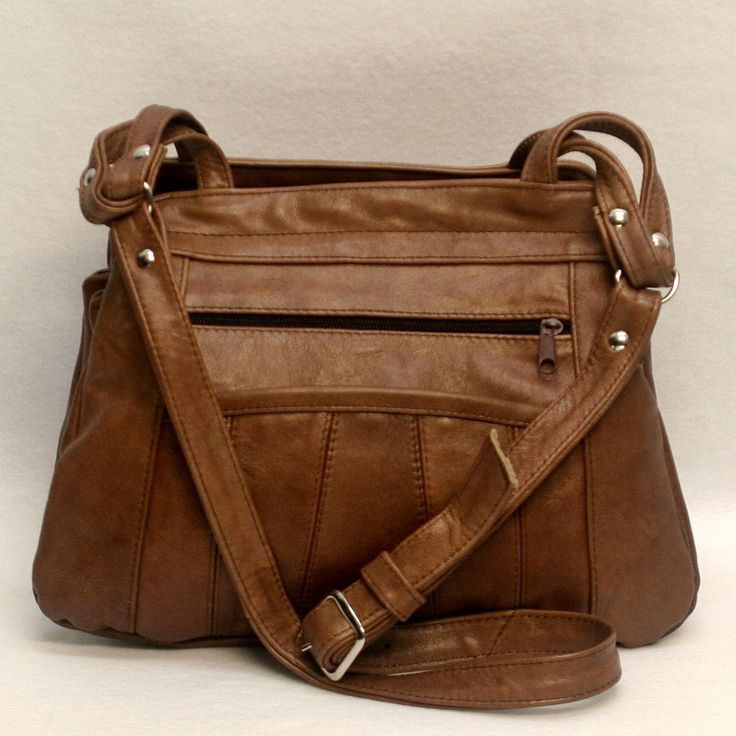 """This genuine leather concealed carry purse has 7 pockets, with 1 concealment compartment that can be accessed from the top zipper or one end via a hook and loop closure. This purse measures 12"""" x 9"""" x                                                                                                                                                      More"""