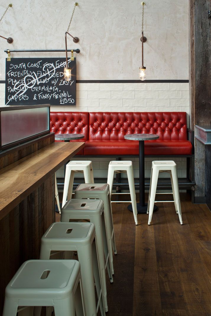 Jamie's Italian in Westfield, Stratford City - Rustic wood and industrial grunge with a pop of white and red