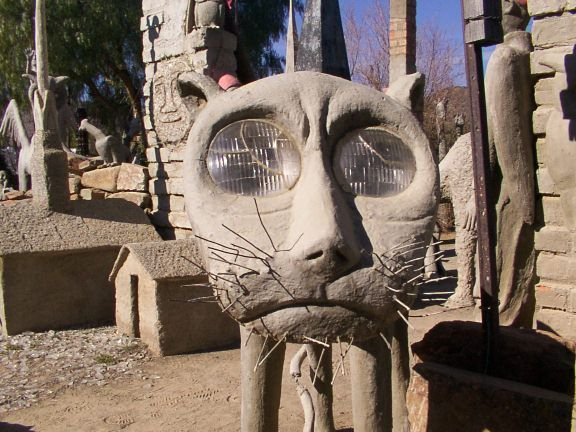 Owl House, Nieu-Bethesda, South Africa - The Owl House was owned by a woman named Helen Martins who was obsessed with light. She started making sculptures and other objects from cement, glass and wire that reflected rainbow colours. She made eerie animals that spilled out of her house and into the yard, but she particularly loved owls, which she associated with intuition and wisdom.