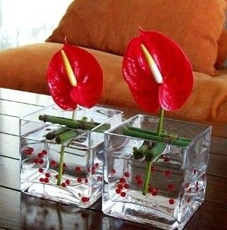 Table floral decoration with red Anthurium - Fiore Floral Decor Ideas
