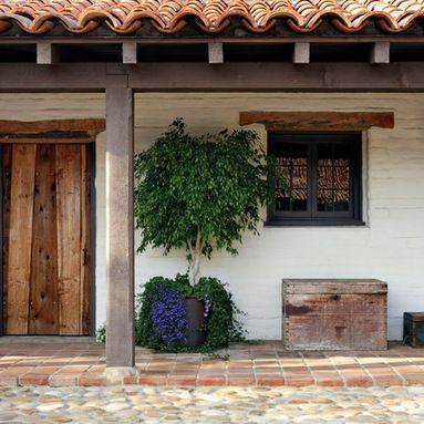 White stucco rustic beams and tile roof