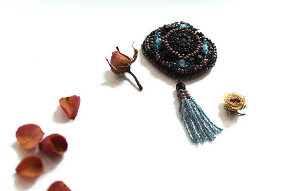 Check out this item in my Etsy shop https://www.etsy.com/listing/550433838/beaded-brooch-embroidered-brooch-black