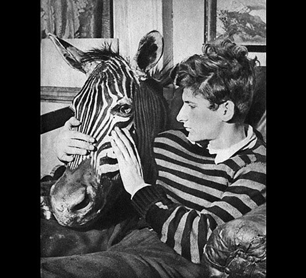 Lucian Freud dressed to match his zebra head, circa 1943. Courtesy Tate Modern. Photo via.