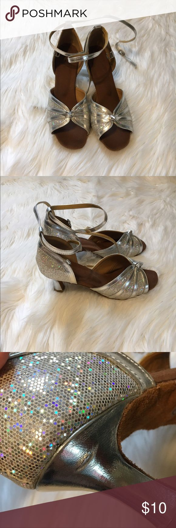 Silver heels These heels were used whil I was in a show choir group. They are very comfy, but worn. There's a scuff mark as pictures. It is a fake clasp which is shown I the pictures as well. Shoes Heels