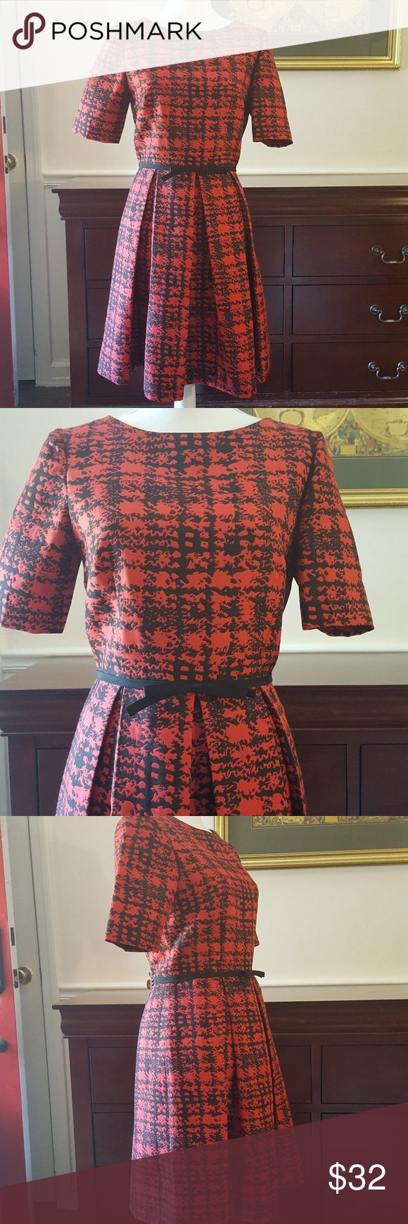 """Black and Red Fit N Flare Dress Just Taylor SZ 8 So pretty. Black and Red Dress with slim bow accent at waist. Back zip. Short sleeves. Excellent Condition. Approximate Measurements: Armpit to Armpit 18"""" Waist 14.5"""" Across  Hip 18"""" Across  Length 36"""" Just Taylor Dresses"""
