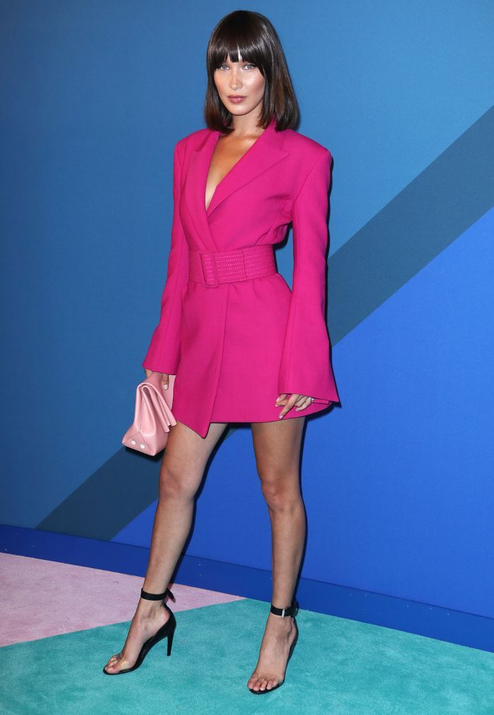 81badce214af Bella Hadid walked the red carpet at the CFDA Awards wearing a blazer as a dress  with naked shoes. See her look.