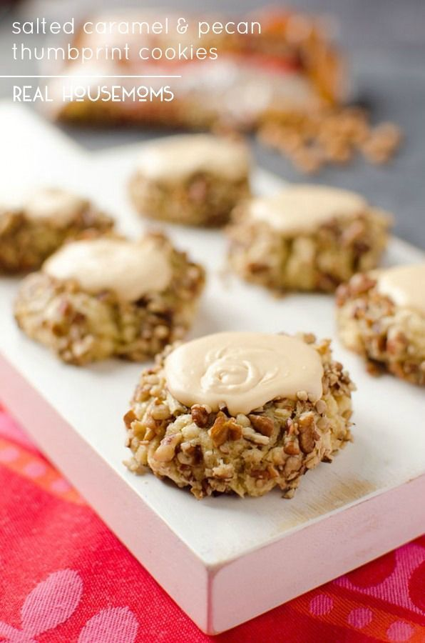 Salted Caramel & Pecan Thumbprints are a rich cookie rolled in pecans and filled with a decadent salted caramel frosting for a sweet dessert that is perfect for the holidays!