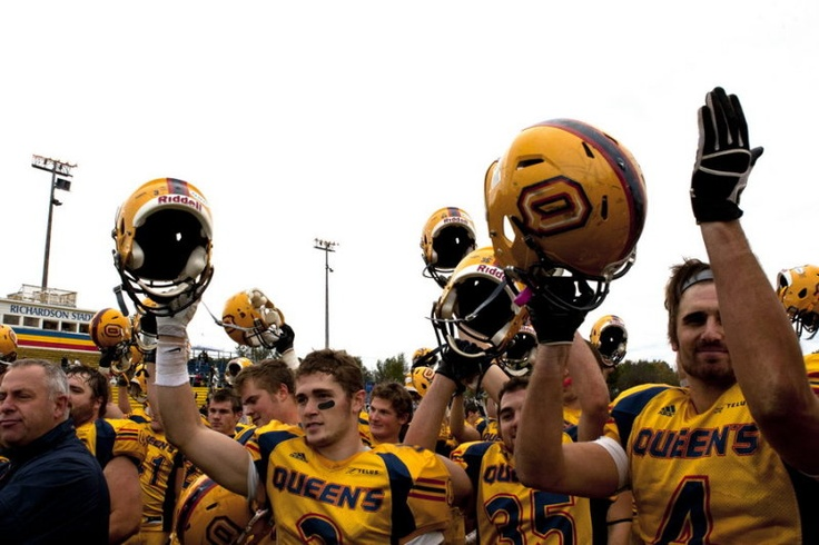 The football team salutes the crowd after beating the No. 1 Western Mustangs   (Jeff Chan)