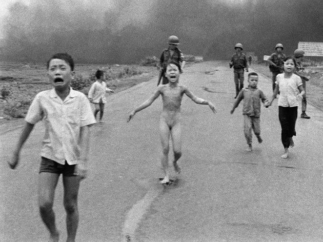 """A very historic photo that might have changed the world.    """"FILE - In this June 8, 1972 file photo, crying children, including 9-year-old Kim Phuc, center, run down Route 1 near Trang Bang, Vietnam after an aerial napalm attack on suspected Viet Cong hiding places as South Vietnamese forces from the 25th Division walk behind them. A South Vietnamese plane accidentally dropped its flaming napalm on South Vietnamese troops and civilians."""""""