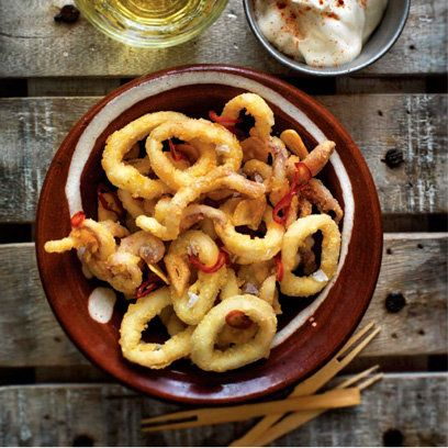 Calamari with fried garlic, chilli, lemon and alioli recipe from 'My Basque Cuisine' by Ash Mair. For the full recipe and more, click the picture or visit RedOnline.co.uk