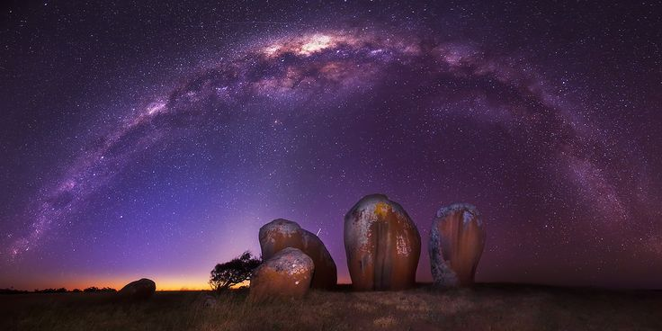 A Henge Beneath - Murphy's Haystacks Streaky Bay South Australia  These granite inselberg rock formations arise abruptly from a paddock of sheep with open surrounds. On this cloudless night, I had one hour between sunset and moonrise to take as many exposures of the milky way high overhead. I was fortunate that there was enough time to trial a few compositions in the dark before settling on this panorama of 14 vertical images.  [edit] There have been a number of print requests for this...