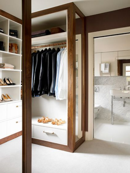 "Bathroom: marble walls. mirrored cabinets all along the wall for ""hidden"" storage and lots of light Contemporary Closet by Amory Brown"