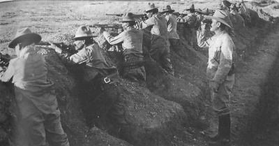Troops of the Constitutional Army await the assault from Pancho Villa's troops at Agua Prieta in November, 1915. They are dressed in US Army surplus, and armed with cast-off American Krag-Jorgensen rifles. The brutal defeat the inflicted on the Villistas, while not the end of Pancho's fight, decimated his forces forcing him to change from conventional tactics into guerilla raids. (Alejandro de Quesada Historical Archives)