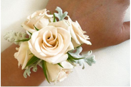 Wrist corsages for the mother of the bride and groom. But please make the mother of the bride's with a bit more silver glitz and pearls.