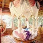 Tropische slaapkamer met rond bed