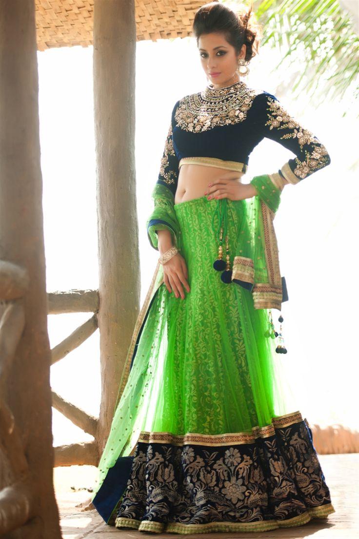 Lovely Green #designerLehengacholi with wide border and high neck full sleeved choli comes with designer #net dupatta.