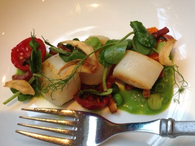 Pan seared scallops with garden broad beans, pea tendrils, semi-dried tomatoes, and pancetta.