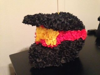 The dirt bike helmet piñata I made for my son's 7th birthday party.