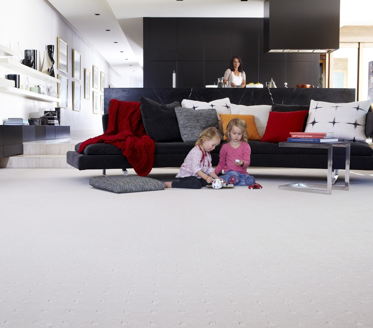 100% wool carpet for playing in a modern living room.  A soft white carpet creates a good base for adding bursts of bright orange and red.  Symphony 1/- Billow