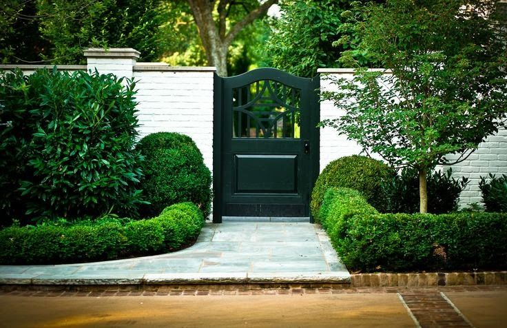 Black Gate Wall Decor : Ideas about brick wall gardens on walled
