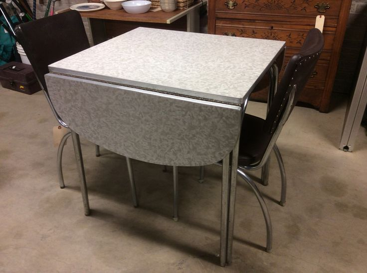 "Mid Century Formica Drop Leaf Table $125 30"" Tall. 29.5"" Deep. 25"" Wide with leafs down. 4' Wide with Leafs extended.   **TIMELESS TREASURES CORNER** Business Hours: Monday through Saturday 10 am to 6 pm Store Phone: (641) 672 - 2544 Call or TEXT Cell: (641) 295 - 0854 ****Location: 121 High Ave West, Oskaloosa. Across the street from Pizza Ranch, MI Ranchito, and JC PENNEY****"