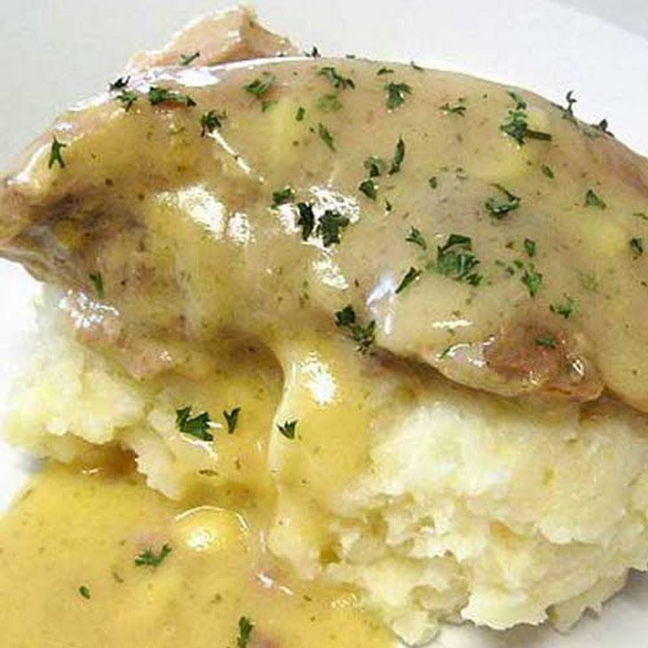 Ranch House Crock Pot Pork Chops with Parmesan Mashed Potatoes Recipe Main Dishes with pork chops, seasoning, cream of chicken soup, cubed potatoes, butter, grated parmesan cheese, roasted garlic, skim milk, salt, cracked black pepper