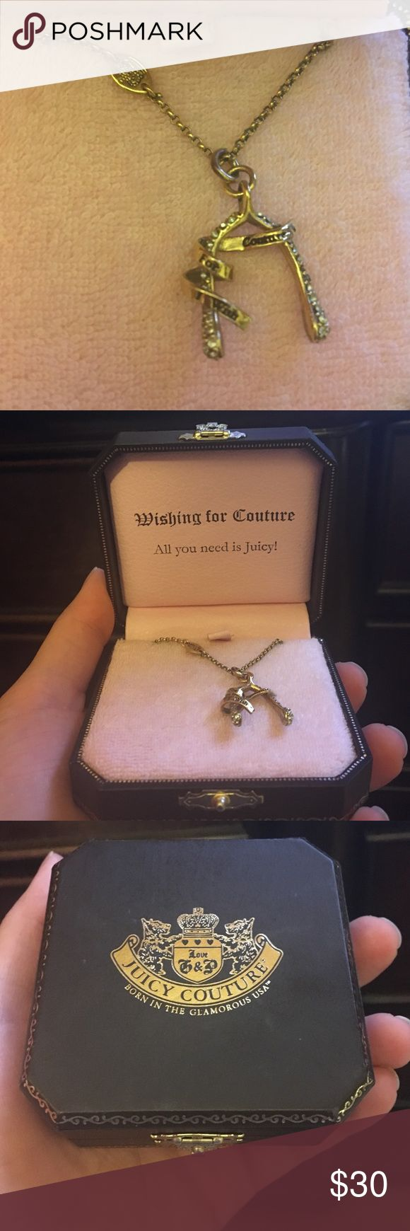 Juicy wishbone necklace Juicy couture authentic. Worn a good amount but is still in good condition. Juicy Couture Jewelry Necklaces