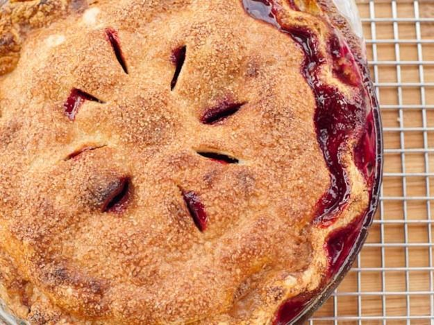 As peaches recede at the end of the summer season and plums come on strong as we inch towards fall, this pie was designed to bridge the seasonal gap. The two flavors compliment each other perfectly, and make the most of the last of the peaches.\n