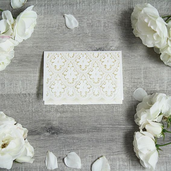 The Pretty in Lace Invitation features a wall of white lace in a pearl finish. This design is perfect for a traditional wedding, classic and timeless!   The detailing is laser cut with the embellishments embossed. Leaving a high end finish for your guests to enjoy.