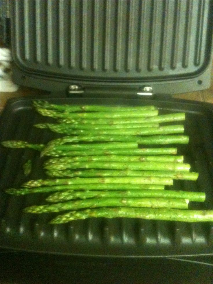 I may never cook asparagus any other way. Got out my George Foreman. In a bag mixed the asparagus with olive oil ( I use coconut), butter, sea salt, garlic, and pepper. Grill for 10 minutes and its crisp tender. It's YUM!  My 14 year old confirmed it!