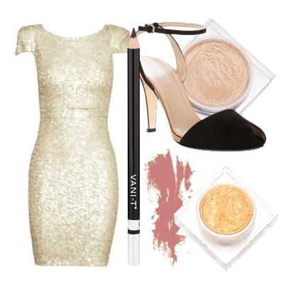 Make understated your statement look! A simple dress splashed in sequins, along with simple, but bold accessories will play up your smoky gold eyes and La Femme Lip Colour.