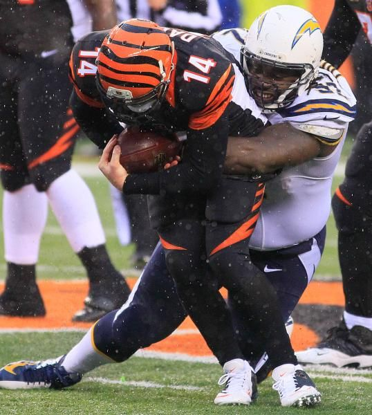 Cincinnati Bengals quarterback Andy Dalton (14) is sacked by San Diego Chargers defensive tackle Cam Thomas