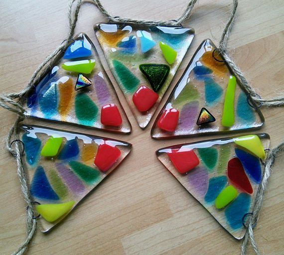 Fused glass bunting, handcut by me and fused in the kiln. This one is bright and multicoloured, when the sun shines through it throws colours everywhere!  A tiny bit of dichroic added for sparkle ( love a bit of sparkle!). It looks lovely hanging in a sunlit window but equally on a summer night with solar lights wrapped around. Ive also used a pound only shops battery lights as they are the perfect length. Great for parties, but lovely for home decor    • string length 108cms • each glass...