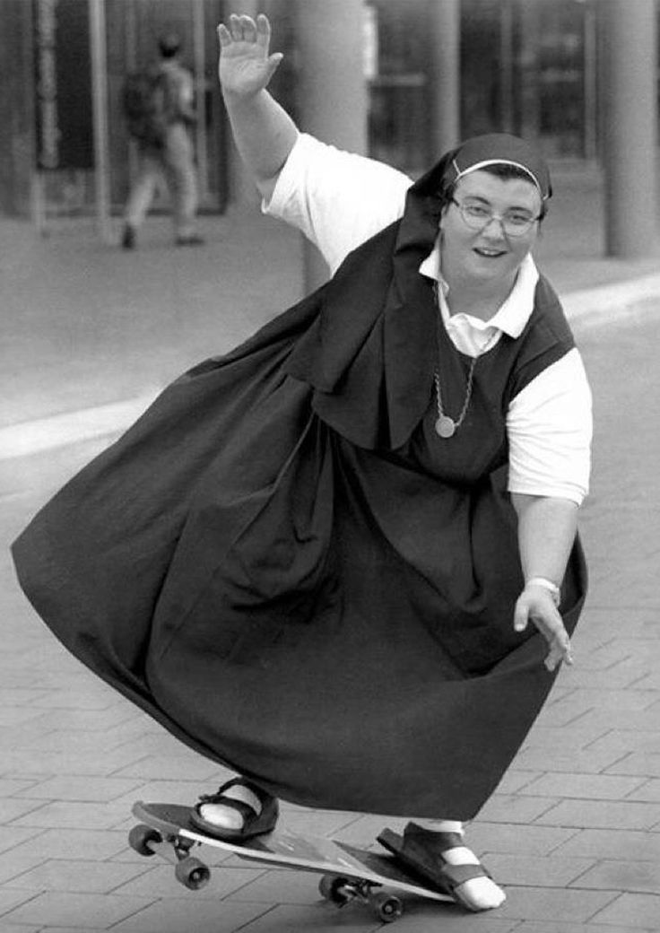 Nun on a skateboard.