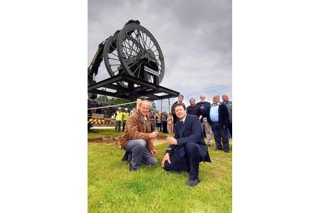 Wellington Mine's headgear wheels were lowered into place in a ceremony to mark its renaissance as a renewables business park. Pictured at the fore are Tim Smit (left) and Richard Freeborn   picture: Emily Whitfield-Wicks